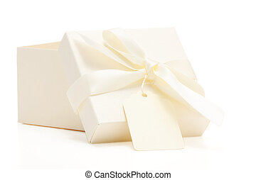 cream colored gift box with bow and name tag