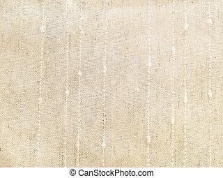 cream colored linen textile - close up of cream colored...