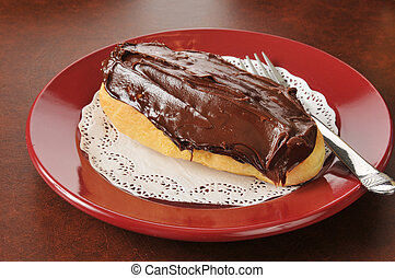 Cream filled eclair with chocolate frosting