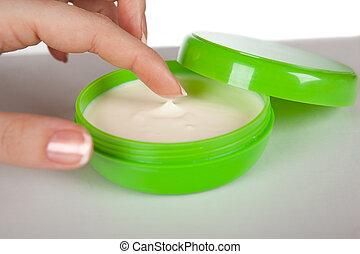 Cream in the hands of women