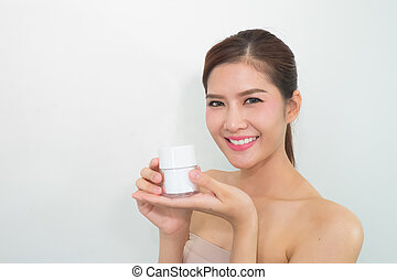 Cream Mask, Portrait of Beautiful Young Woman looking at Camera. Beautiful Asian female model on White background