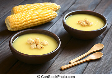 Cream of Corn Soup with Croutons - Two bowls of cream of...