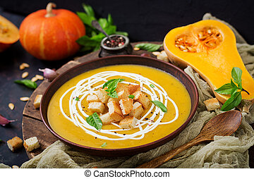 Cream of pumpkin soup with sour cream sauce