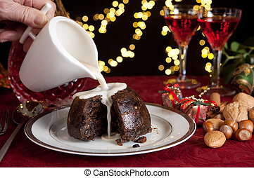 Cream on a christmas pudding - Christmas dinner table with...