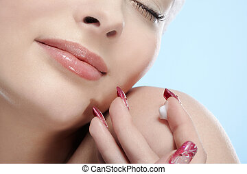 cream on girl\'s finger - beautiful healthy serene girl with...