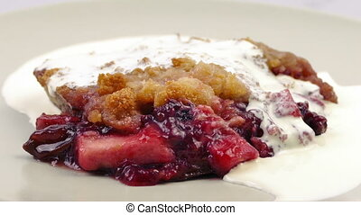 Cream Poured On Fruit Crumble - Cream pours on delicious...