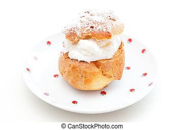 Cream puff - A cream puff on the white background