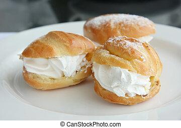 Cream puffs fancy choux pastry with powdered sugar