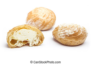 Cream puffs on white background