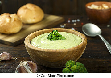 cream soup in a plate on wooden background