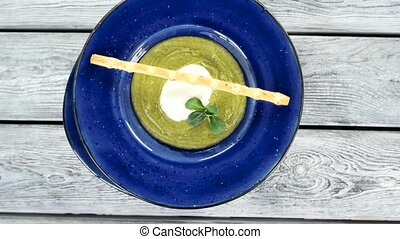 Cream soup with poached egg. Healthy food top view.