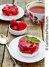 creamy and strawberry soufflé on a dark wood background....