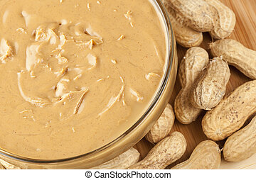 Creamy Brown Peanut Butter on a background