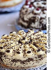 Creamy cakes on a buffet table