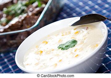 Creamy corn soup - A shot of creamy corn soup in a banquet