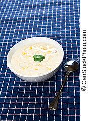 Creamy corn soup - A shot of delicious creamy corn soup on a...