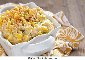 Creamy corn - Fresh creamy crock pot corn on a table