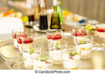 Creamy cup desserts on silver tray cafeteria delicatessen