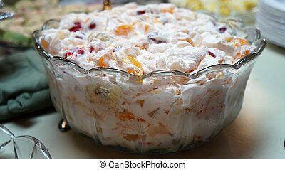 creamy fruit salad in a crystal bowl
