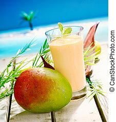 Creamy mango and yoghurt smoothie - Glass of creamy mango...