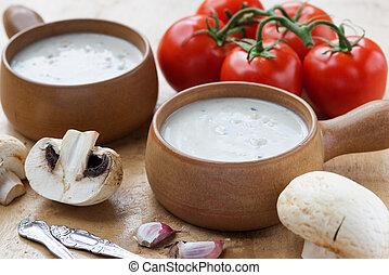 Creamy mushroom soup in two clay pots