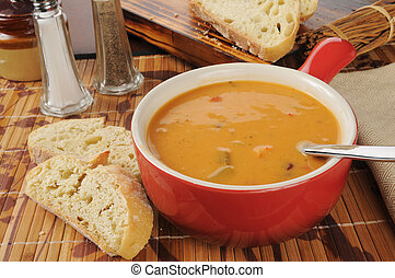 Creamy tomato bisque with gouda cheese and chicken