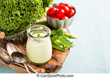 Creamy vegan avocado sauce or salad dressing