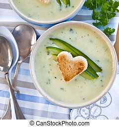 Creamy vegetable soup with fresh cucumber and toasted bread