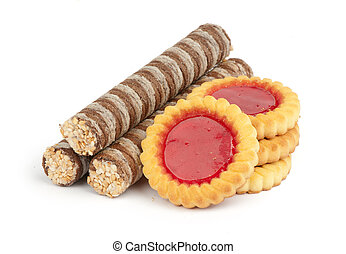 creamy wafer rolls and cookies with jam