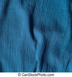 Creased blue cloth material fragment as a background texture