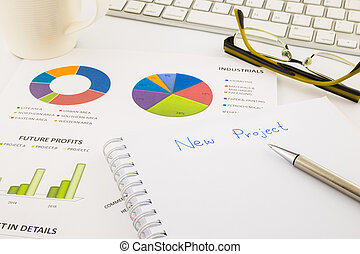 create ideas for new project, graph and chart with blank paper on office table, business concept