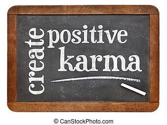 create positive karma - text on blackboard