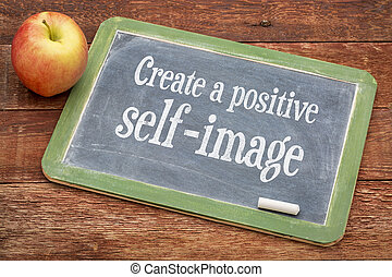 Create positive self image - inspirational words on a slate blackboard against red barn wood