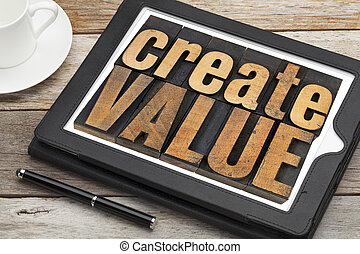 create value - inspirational text in vintage letterpress wood type on a digital tablet with a cup of coffee
