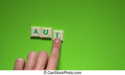 """Created word of """"Autumn"""" with the letters on the green..."""