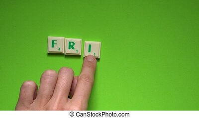 "Created word of ""Friday"" with the letters on the green..."