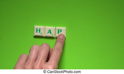 "Created word of ""happy"" with the letters on the green..."