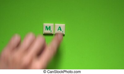 """Created word of """"May"""" with the letters on the green..."""