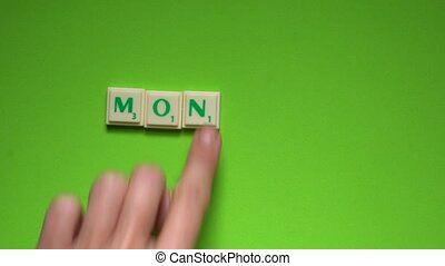 """Created word of """"Monday"""" with the letters on the green..."""