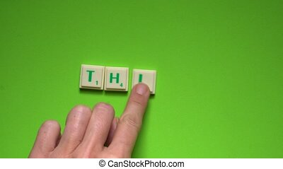 "Created word of ""think"" with the letters on the green..."