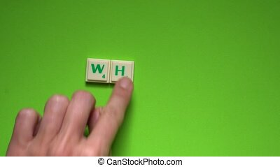 "Created word of ""when"" with the letters on the green..."