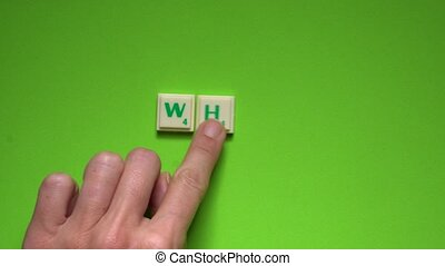 "Created word of ""why"" with the letters on the green..."