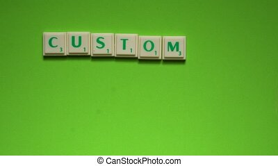 """Created words of """"customer service"""" with the letters on the green background"""