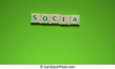 "Created words of ""social media"" with the letters on the green background"