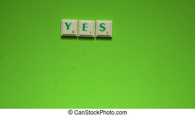 "Created words of ""yes or no"" with the letters on the green..."
