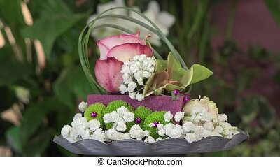 creating a flower arrangement - Floral composition on a...