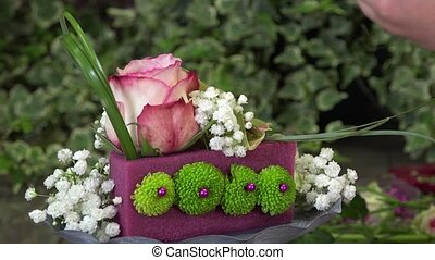 creating a flower arrangement - the flowers are stitched in...