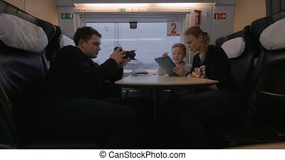 Creating footage of mom and child using pad during train...