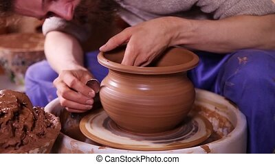 Creation of a clay pot - Experienced potter creating a clay...