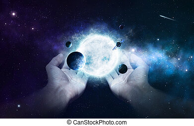 Creation - Two hands holding the sun and planets in the...